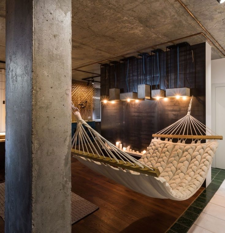 This isn't your traditional wall décor for an apartment's small living room! Not enough space for a sectional? Try a Hammock! This studio apartment's décor will leave your guests entertained and wanting more!