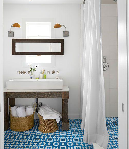 Patterned, coloured tiled floor, white walls