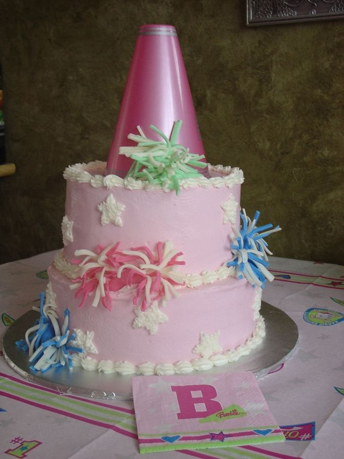 This Stacked Cake Is Iced Smooth In Pale Pink Buttercream Pom Poms  cakepins.com