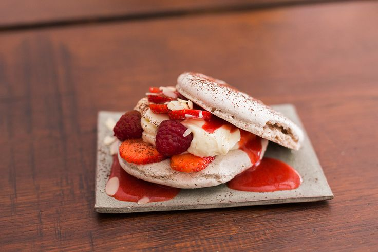 Delicious strawberry macaroon dessert at Muse Berlin