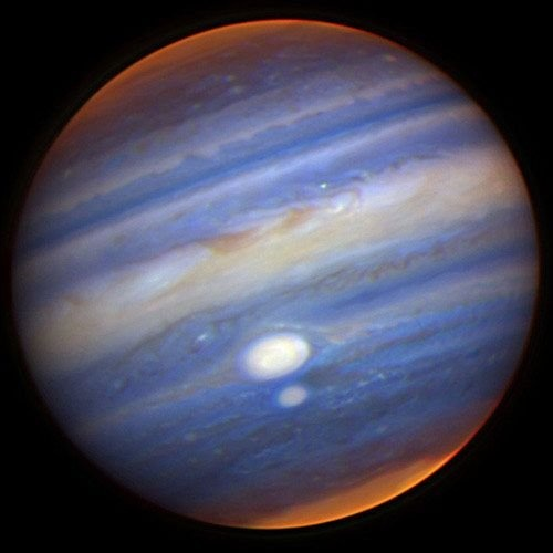 Jupiter: King of planets - Giant of gas dwarfing others - With storming spot