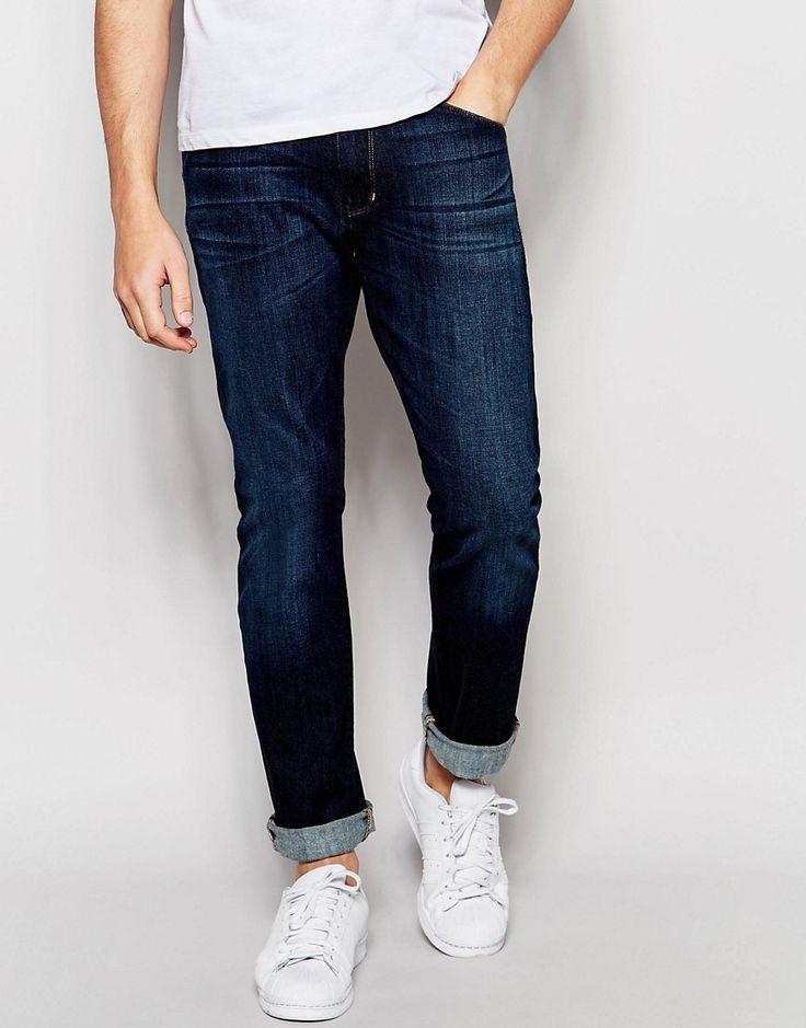 Image 1 ofWrangler Larston Slim Tapered Jeans in Broken Patina