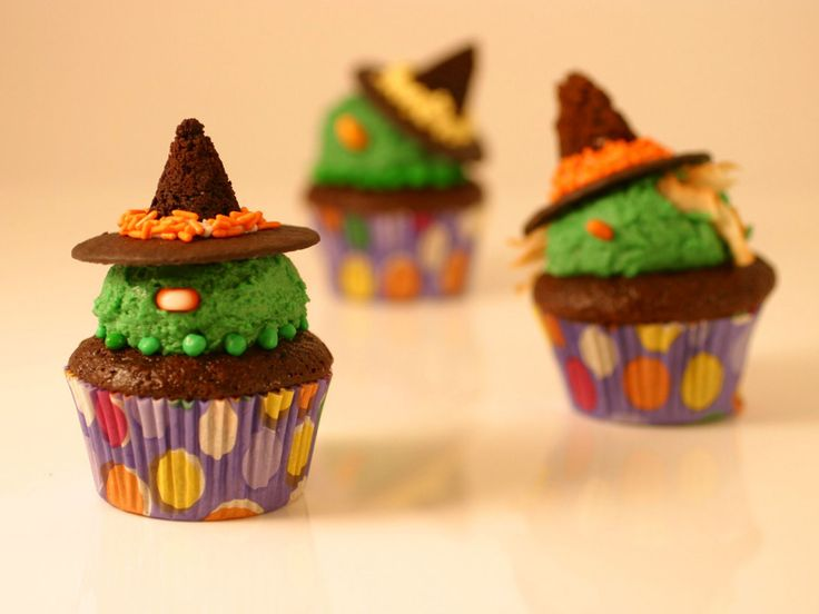 Wicked Witch Cupcakes : Turn your chocolate cupcakes into wicked witches by adding colored frosting, wafer cookies and candy eyeballs.