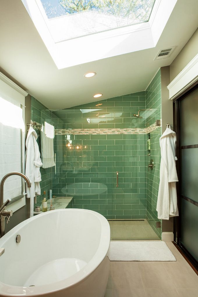 Large glass(?) shower tiles. Refreshing color. No messy curtain! No step in tub...just walk in. (House of Turquoise: Renewal Design-Build - http://www.houseofturquoise.com/2013/06/renewal-design-build.html)