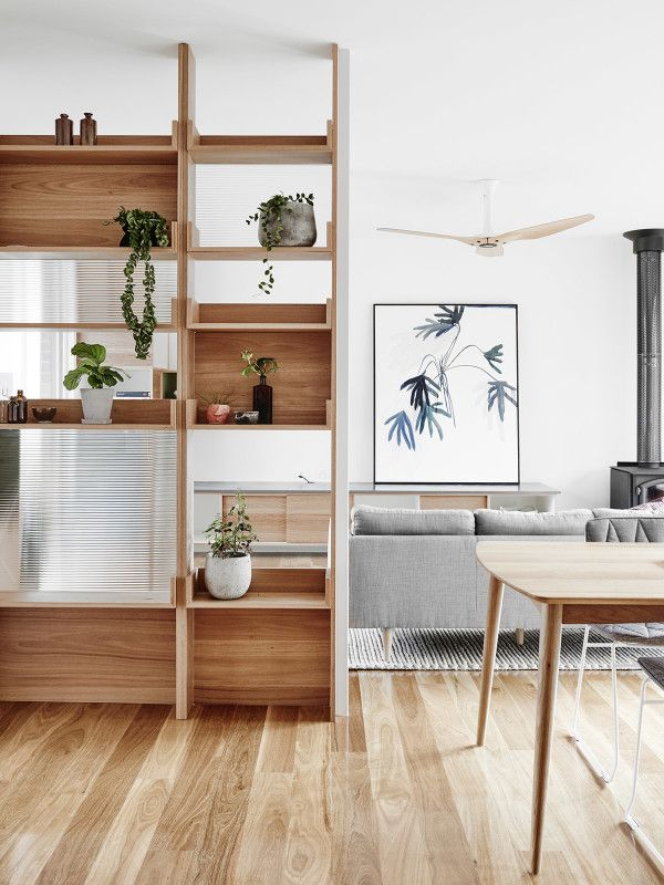 Open shelving provides architectural interest while letting the light through. I like that there are a few closed spaces that you could either leave blank for the warm would texture, or display a little artwork on the other side of them.
