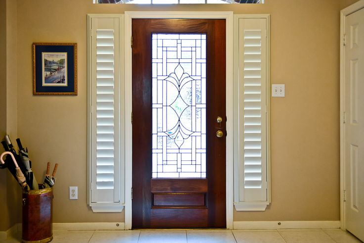 Plantation shutters on the sidelight windows by the front for Front door with 6 windows