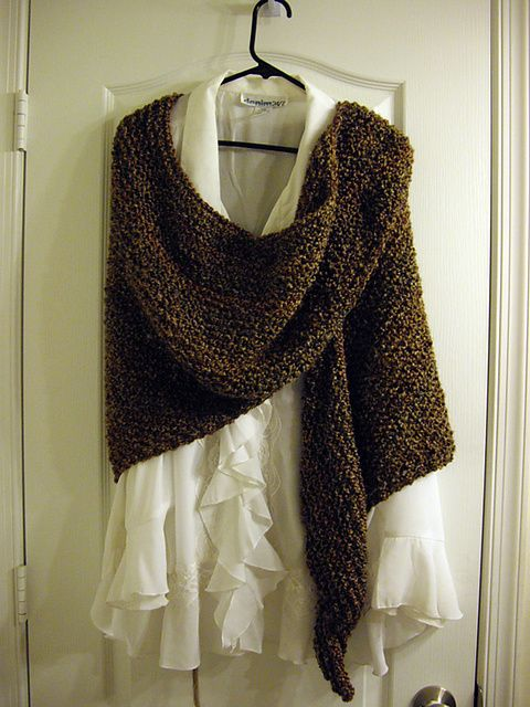 Ravelry: Janet's Shawl pattern by Janet Jameson.  I just finished this using homespun painted desert color. so pretty and very cozy soft.