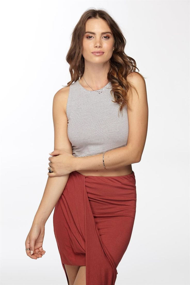Stripe High Neck Crop, is a bodycon fit with a high round neckline in a cropped length, pair back with jeans or a maxi for a cute look. 95% cotton 5% elastane.