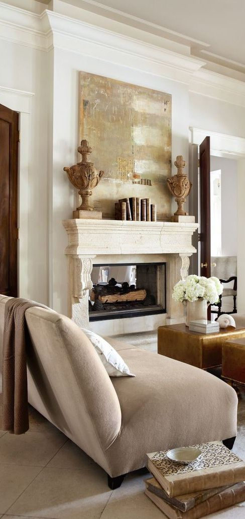 Like the idea of the neutral tones above the fireplace for color and height. wouldl hide tv cords well if tv is elevated. also love the urns