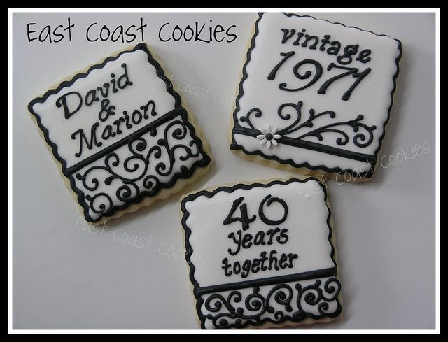 40th Wedding Anniversary cookies    Some of the 60 40th Wedding Anniversary cookies I made a few weeks ago. Went with 3 different designs for a cocktail reception the family was planning.