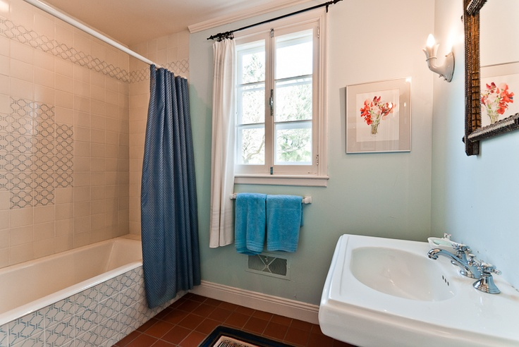 Delightful tile, french windows, and a full bath come together to capture the captivating charm of country chic. Bright robin's egg blue delights the eyes, and beyond those curtains there's a view that is sure to take your breath away.