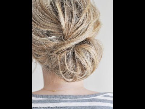 Low bun (chignon)-this blog is amazing! It includes picture & a how-to-video! It isn't pulled back silky and smooth. It's a messy style, and that's perfect for mommies like me!