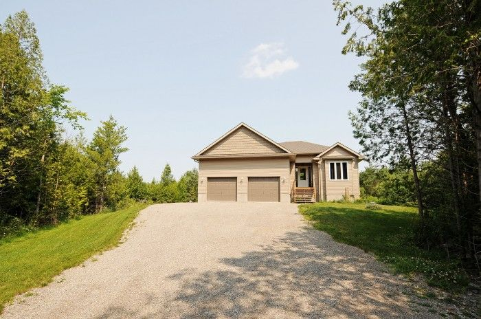**JUST LISTED** 238 Richmond Rd! Located in Beckwith TWP just a short drive to Carlton Place, Richmond and Ashton Station. 2012 bungalow with 2 bed, 2 full bath on the main and 2 bed, 1 full bath in the basement on a lovely and private 1.85 acre wooded lot. Visit www.JohnDonovanProperties.com or www.238richmond.com