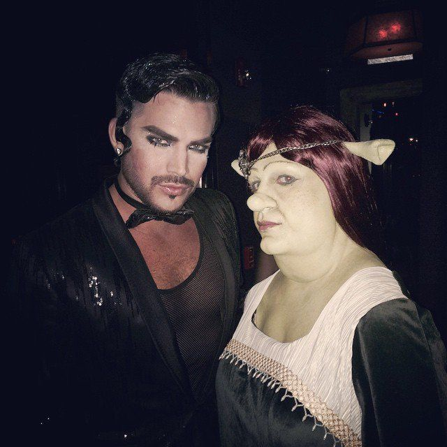 Pin for Later: Look Back at Last Year's Best Celebrity Halloween Costumes! Adam Lambert and Colton Haynes as a Man in Black and Princess Fiona The singer hit the town in an all-black ensemble, and the handsome actor looked completely unrecognizable as Princess Fiona from Shrek.