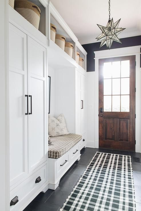 Positioned Under Shelves Holding Woven Baskets White Closed Lockers Contrasted With Oil Rubbed