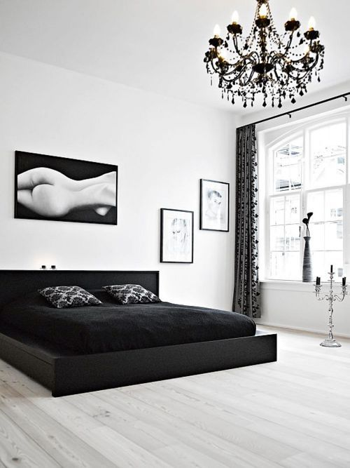 Minimalist black and white bedroom... love The contrast of The bedding and the floors