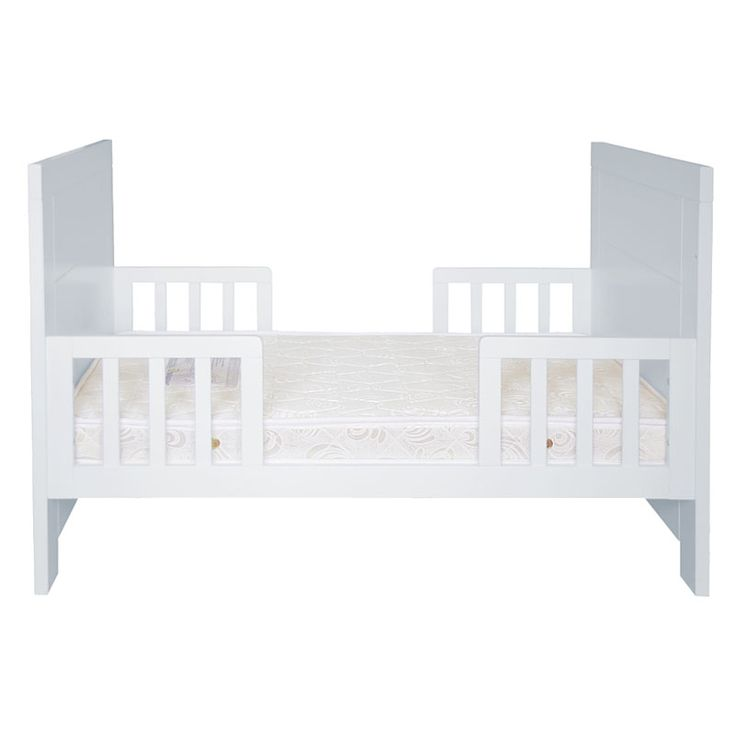 white toddler bed which converts from a cot and to a lounge
