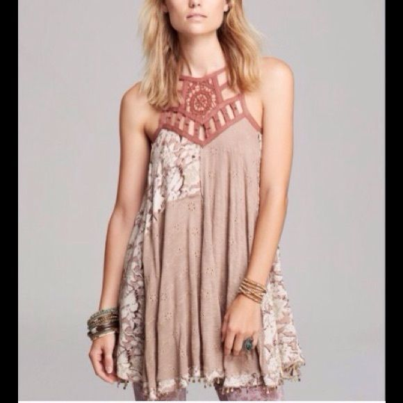 COMING SOON! FREE PEOPLE EYELET MEADOW DRESS/TUNIC Simply beautiful Eyelet Meadow  dress/tunic by Free People. This taupe combo tunic is sleeveless and has a beaded hem. These pictures don't do this beauty an justice. Coming soon, Comment me here if interested and I can reserve.  SOLD OUT EVERYWHERE Free People Dresses Mini