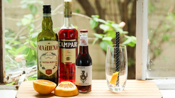 SMOKED COLA AMERICANO: A wonderful smokey twist to the Americano, substituting the soda water for organic cola. Mixed with Campari, Maidenii Sweet Vermouth, StrangeLove Smoked Cola and some orange zest. Recipe on the blog.