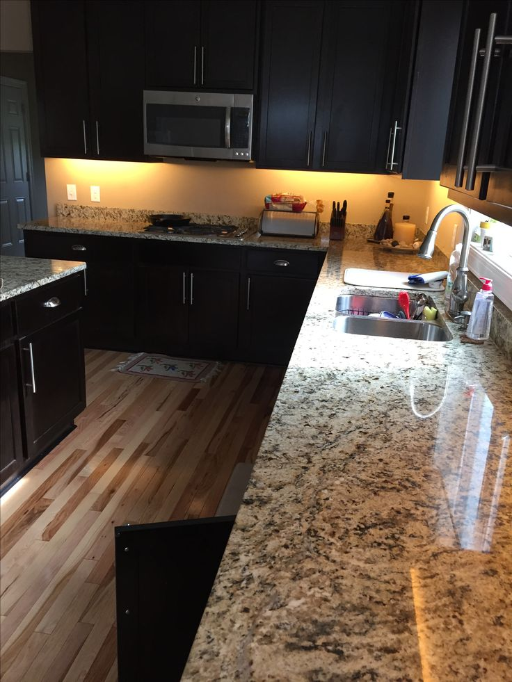 LED lighting kitchen - dark espresso cabinets and Santa Cecilia granite countertops