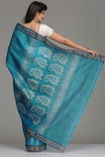 Turquoise Blue Tussar Silk Saree With Blue & Gold Zari Striped Border & Pallu With Ivory & Gold Paisley & Floral Motifs