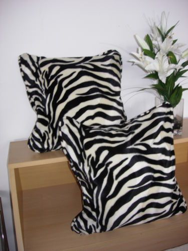 Animal Print Cushions #bedroom #bed #cushions #animalprint #animalprintfurniture #drawers #zebraprint