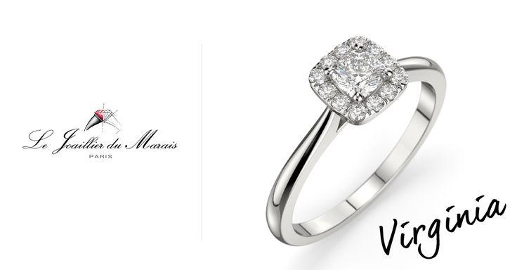 VIRGINIA est une bague en or 18 carat ou platine composée d'une pierre centrale d'environ 0.30 carat de forme coussin et entourée par 12 diamants pour un poids total de 0.12 carat et de qualité G SI1.