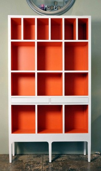bookcase with red interior. Maybe I can revamp my second-hand bookshelf doing something like this. It definitely needs a perk up. And with all the books and such you wouldn't see AS MUCH of a fun bright color....hmmmm.....