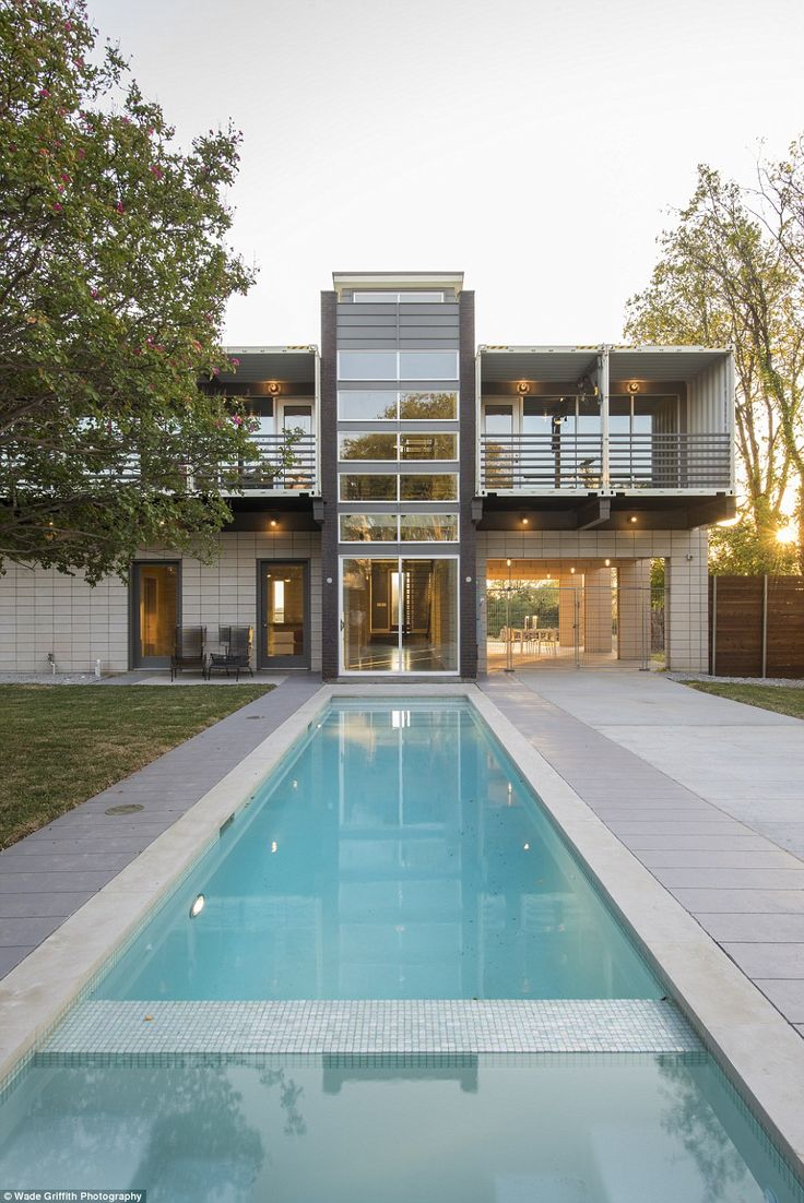The 3,700 sq ft three-bedroom home, dubbed 'PV14,' boasts a 40ft long swimming pool on the ground floor that reflects the two-story glass-paneled tower, also built out of the containers
