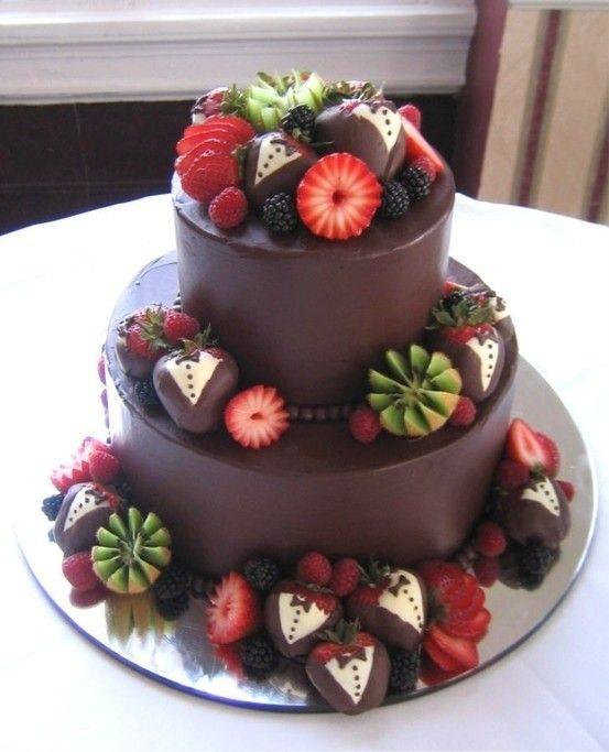 Fancy chocolate cake with fresh fruit. --> I love the decoration on the strawberries! :)