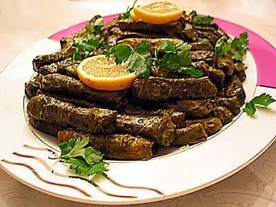Sarma (Grape Leaves)  -5 pieces onion  1 tea cup olive oil  1.5 to 2 tablespoons pine nuts (pine nuts)  2 cups rice  1 tablespoon dried mint  1 to 1.5 tsp black pepper  1 teaspoon cinnamon  2 cutting sugar  2 tablespoons currants  lemon juice  1 cup chopped parsley  1 teaspoon salt  1 tea cup of boiled water  ½ kg pickled vine leaves  half a cup olive oil  2 cups boiling water  Preparation:   1. Chop the onion cooking 4-5, 1 cup olive oil, and 1.5 to 2 tablespoons of pine nuts (peanuts until…