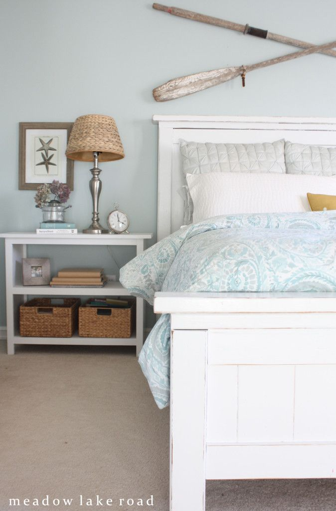 master bedroom white furniture.. Oars on the wall