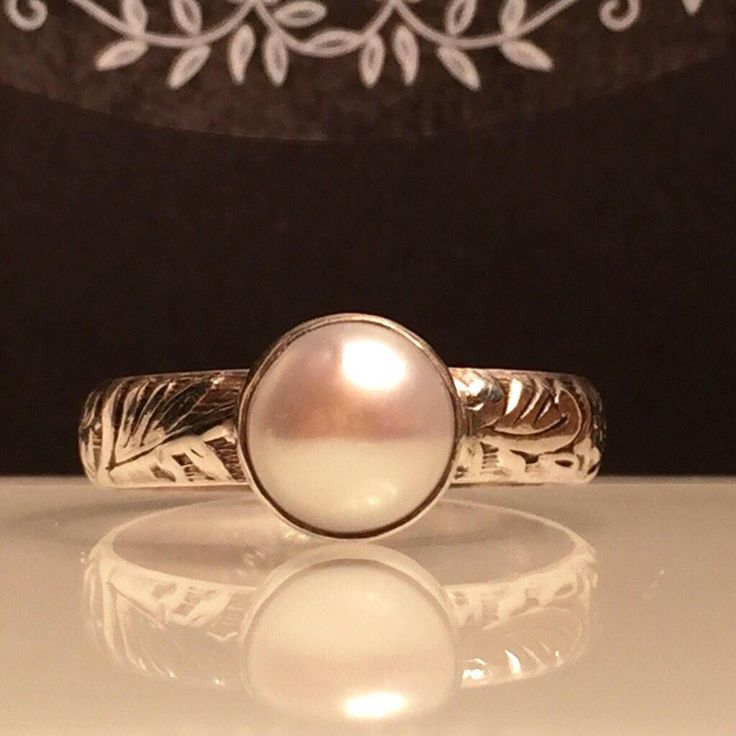 A personal favorite from my Etsy shop https://www.etsy.com/listing/505183022/solitare-pearl-ringsilver-pearl