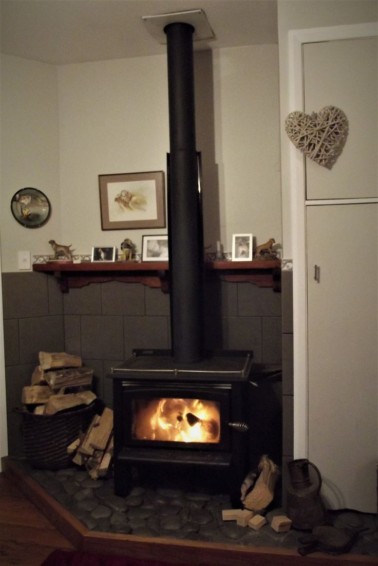 Renovated fire place in our 1890's villa, Marton, New Zealand. Stones for the heart collected from the local river then sealed. Native timber hearth surround and mantel, Slate tile surround. Walls painted in Resene 1/2 Truffle, trim in Resene  1/4 Black-White.