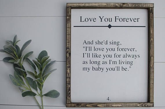 This sign is a book page quote from the book love you ...