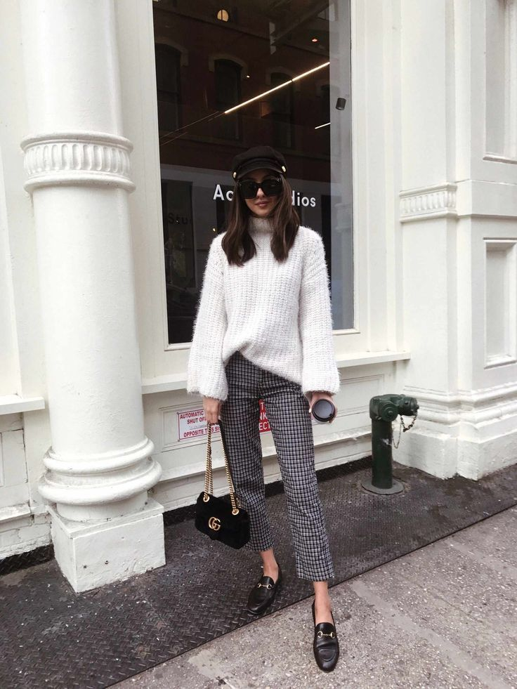 Styling cropped trousers with a white turtleneck sweater