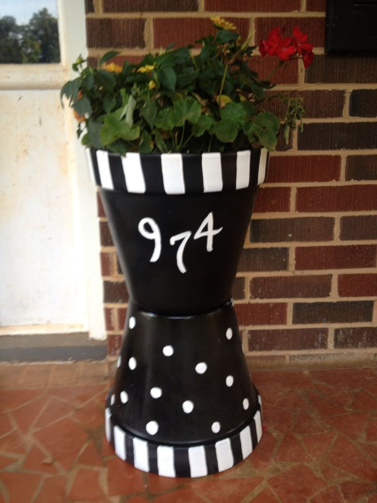 Cute front porch planter made from terra cotta pots
