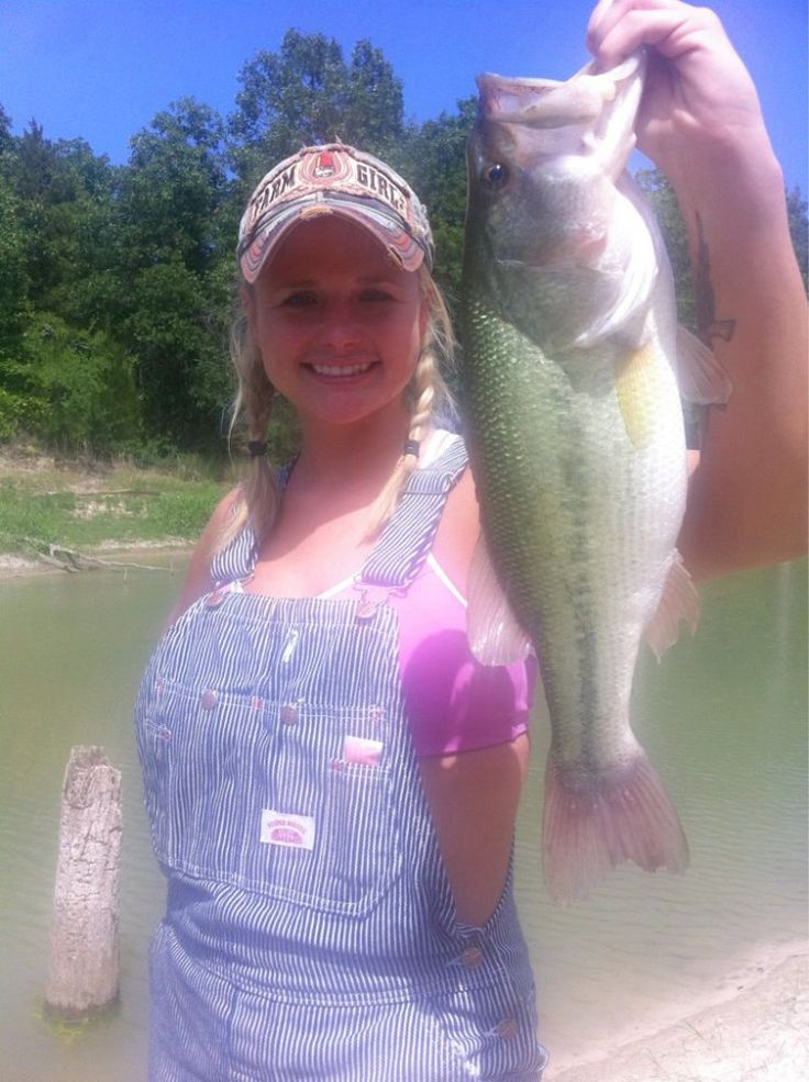 It's not your typical bikini pic, but Miranda Lambert is all smiles on her honeymoon last year in bikini top and overalls with one big ole bass.