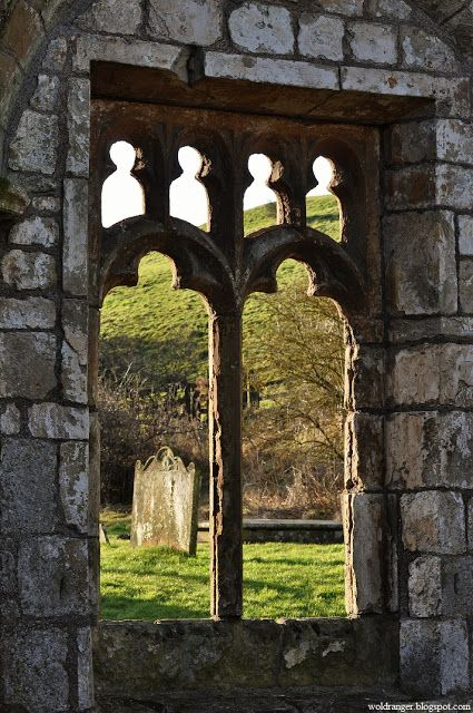 The ruins of:the church at the abandoned Medieval village of Wharram Percy, Yorkshire. One of the best known abandoned Medieval Villages in England. The village was finally abandoned in the 1500's when the lord of the manor turned out the last few families and knocked down their homes to make way for extra sheep pasturage.