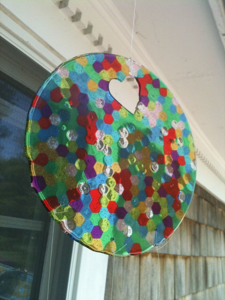 Homemade sun catcher . Drilling caused cracks, but rivets or cookie cutters make perfect holes.