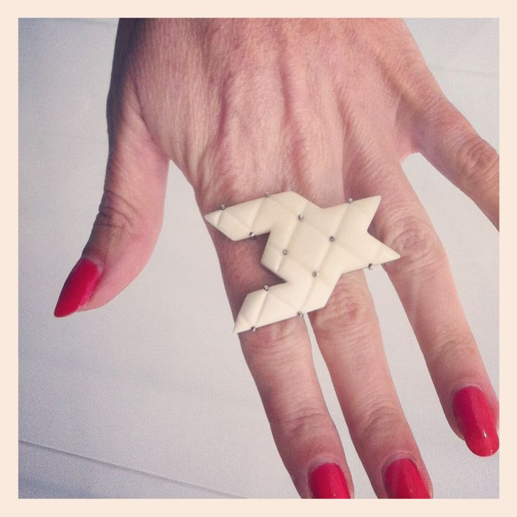 Octavia Cook, Canine Bovine Liaison Ring, 2013 (she describes it as a single piece of houndstooth - mysterious when removed from its pattern) as modelled by a well manicured visitor to Auckland Art Fair