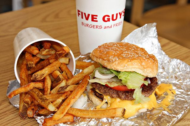 Five Guys. High Five! Peanuts for desert. The fries are made on site and cooked in peanut oil.