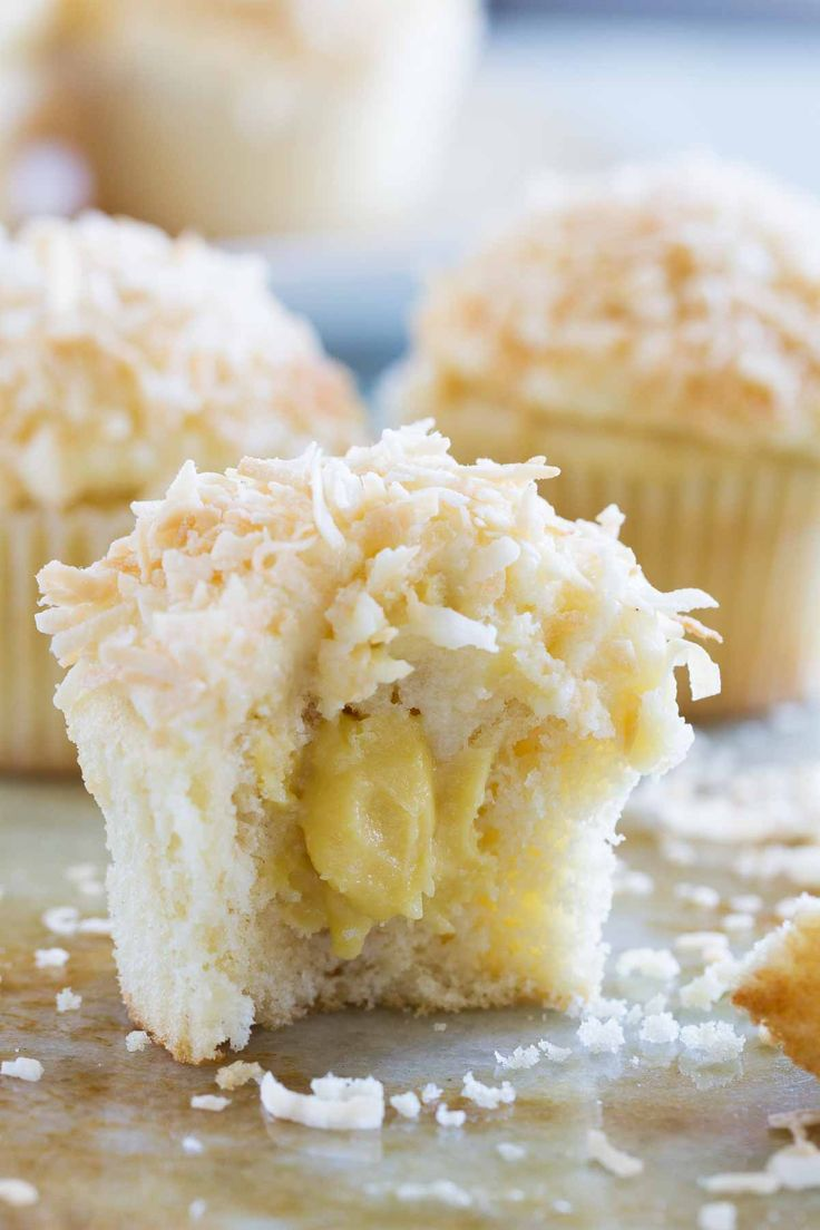 Coconut Snowball Cupcakes! Coconut cupcakes are filled with a coconut ...