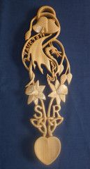 Celtic dragon with bells, daffodils, date and initials