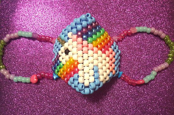 This listing is for a Unicorn Rainbow Kandi Mask  ♡ Perfect for upcoming concerts, parties or raves ;) ♡  👽👽👽👽👽👽👽👽👽👽👽👽  This is READY TO SHIP!  👽👽👽👽👽👽👽👽👽👽👽👽👽  ~Shipping Details~ This item will be shipped by USPS 2-3 Day Priority Mail Flat Rate Box with free Tracking.  ♡ Only pay shipping for the first item, every item after is free shipping! ♡  👽👽👽👽👽👽👽👽👽👽👽👽👽  ❤ If you have questions or comments about the item, please feel free to message me!  ♡ Visit my…