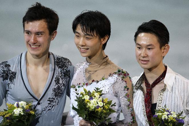 Yuzuru Hanyu of Japan, centre, Patrick Chan of Canada, left, and Denis Ten of Kazakhstan