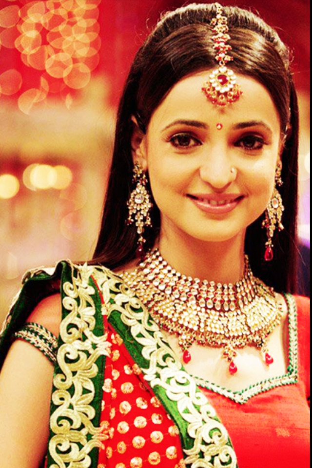 She is a great character. A great role model for all Indian girls. Sweet, decent, respectful, religious, caring, and feisty with her husband.
