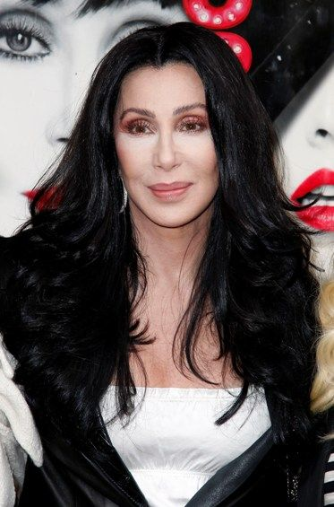 Cher dazzles with red curls