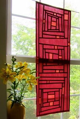 two colors of shot cotton, a magenta and a peach, make a shimmery jewel-toned pojagi panel for the window.