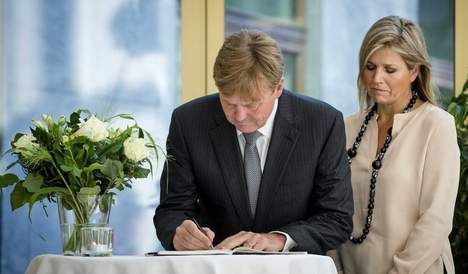 Dutch King and Queen signing the book of condolences for all victims of Malaysia Airlines flight MH17, which was shot down in the Ukraine on 17 July 2014 killing 298 people.